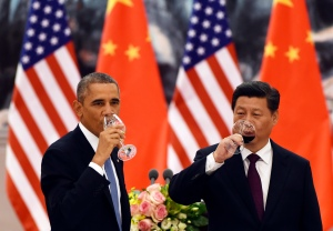 U.S. President Barack Obama (L) and Chinese President Xi Jinping have a drink after a toast at a lunch banquet in the Great Hall of the People in Beijing November 12, 2014. Obama is on a state visit after attending the Asia-Pacific Economic Cooperation summit.  REUTERS/Greg Baker/Pool    (CHINA - Tags: POLITICS) - RTR4DTFJ